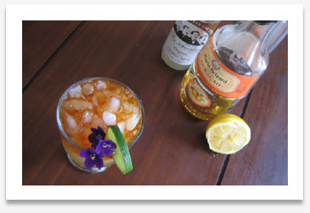 Picture of Waikikian with Marie Brizard orange curacao, Fee Brother's orgeat syrup, and a lemon cut in half, dripping juice.