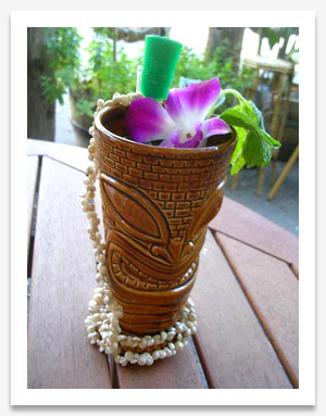 A tasty looking tiki mug filled with drink