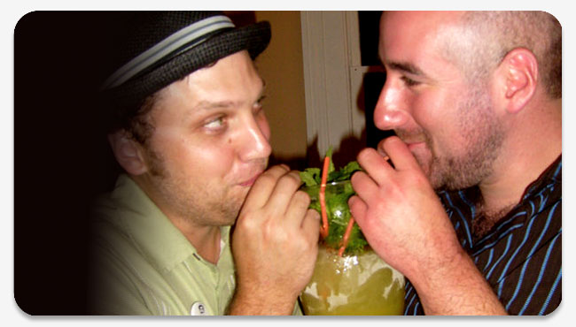 Gabe and Rick looking lustily into each other's eyes while delicately sipping a Chartreuse Swizzle